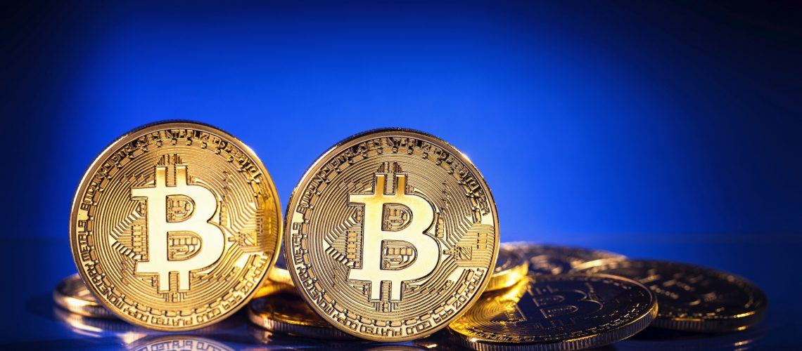 Gold bitcoins on a blue background